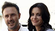 David Arquette, left, and Courteney Cox Arquette   pose together at the launch of The Cheesecake Factory's Drive Out  Hunger  Tour benefiting Feeding America in Culver City, Calif. on  Monday, Aug.  31, 2009.  (AP Photo / Matt Sayles)